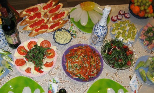 12 Dishes on Russian table during The New Year's Eve